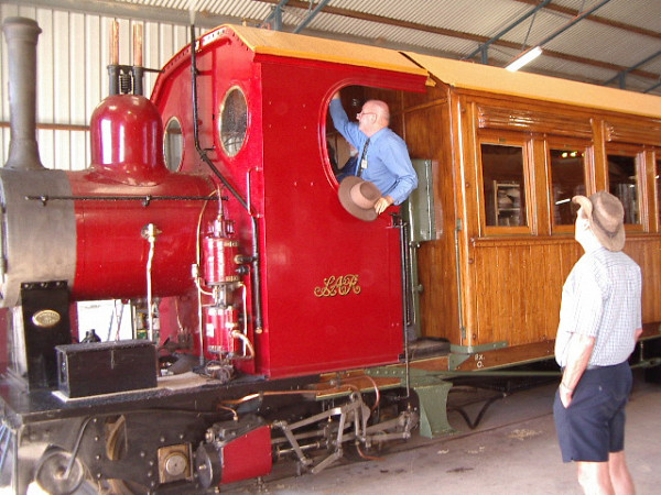Australia's most famous railfan at the controls of our famous Coffee Pot steam motor coach. Tim Fischer AC, guest of honour at the Steam Up Quorn event, blows the Coffee Pot's whistle before driving it a short distance, 23 May 2005 (Photo: David Southon)