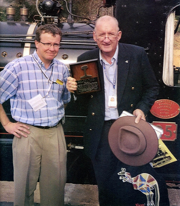 PRRPS President Phil Mellors presents Tim Fischer with a piece of the original 1878 Hopkins Gilkes wrought iron rail from the Port Augusta and Government Gums railway on 1 February 2004. The occasion was the first Ghan to Darwin, which ran parallel with Pichi Richi's train into Port Augusta. (Photo: Scott Reubenicht)